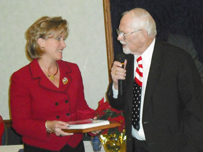 Photo of Kent Stephens presenting certificate of appreciation to Ann Wagner