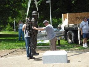 placing the statue